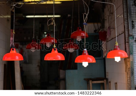 red lanterns & neon lights in old room