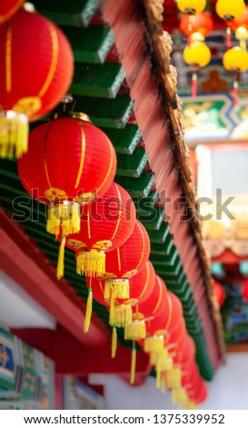 red lanterns of buddha temple, vertical shot, selective focus