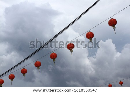 Red lanterns series with cloudy sky in the background