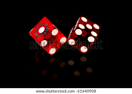 Red Las Vegas Craps Game Dice isolated on a black background.