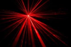 Red laser beam light effect on black background