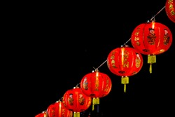 Red latern Chinese style decoration on electrict line for Chinese new year festival in night time. China art culture concept.(Chinese language on red lantern means luck ,good health and be rich)