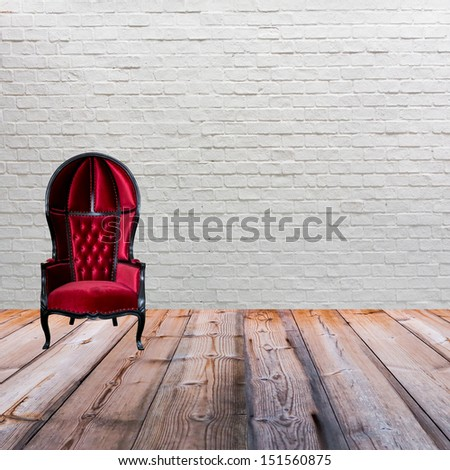 red leather armchair on wood...