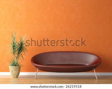 red leather couch and plant on orange wall