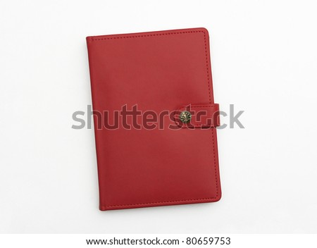 Red leather journal notebook diary isolated on white background