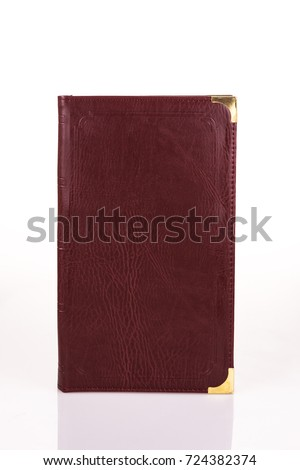 Red leather menu folder on light background with reflection. #724382374