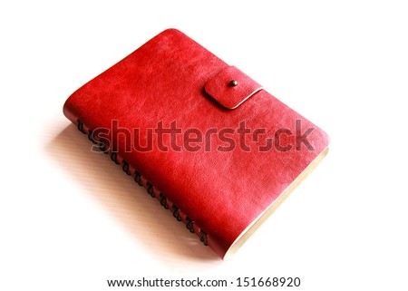 Red leather notebook on white background