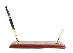 Red leather pen holder isolated over the white background