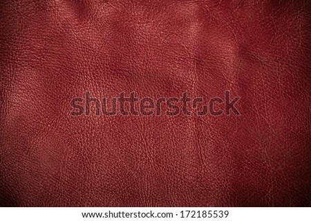 Red leather texture closeup grunge background. Country western background, cowboy rawhide design, abstract pattern