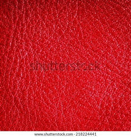 Red leather texture closeup grunge background. Country western background, cowboy rawhide design, abstract pattern. Square format
