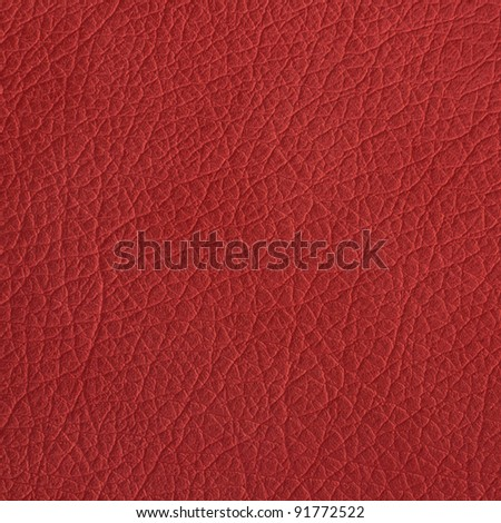 Red leather texture closeup, useful as background