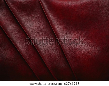 red leather texture designed with 3 stripes - stock photo