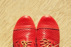Red leather women's boots with laces in vintage style. Top view. Women's shoes