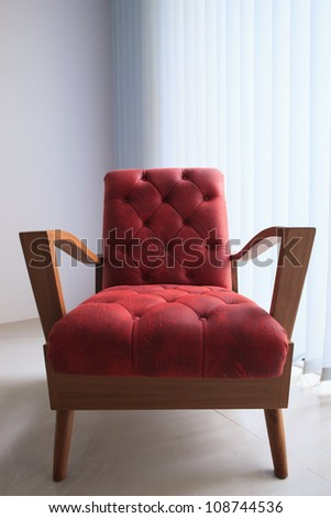 red leather wooden sofa in white room