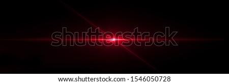 Red lens flare light on black background Foto stock ©