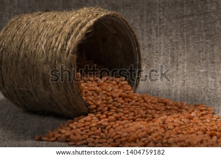 red lentils  poured out, scatter of cans of handmade. lentil texture, lentil pattern, background, macro. concept of healthy eating. concept of vegetarian food #1404759182