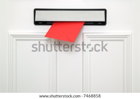 Red letter coming through a chrome letterbox on a white door. Could be a Valentines, Christmas, Birthday or other greetings card.