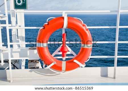 red life buoy on side of sea cruise liner