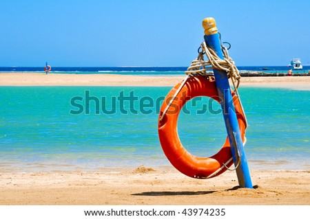 Red life buoy on the beach of Egypt