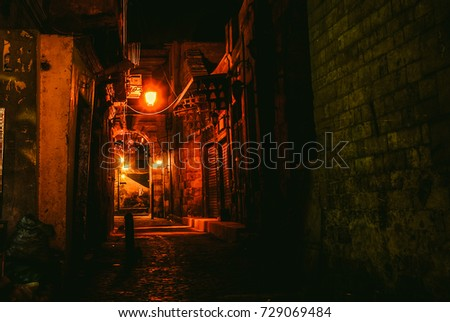 red lighted alleyway in old...