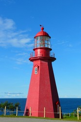 Red lighthouse on the Canadian coast.