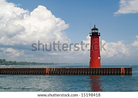 Red lighthouse under dramatic blue and white sky in Kenosha, Wisconsin; Lake Michigan