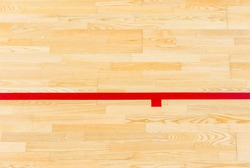 Red line on the gymnasium floor for assign sports court. Badminton, Futsal, Volleyball and Basketball court