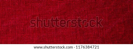 Red Linen fabric crumpled texture, copy space banner. Stone washed pure linen red background, macro banner