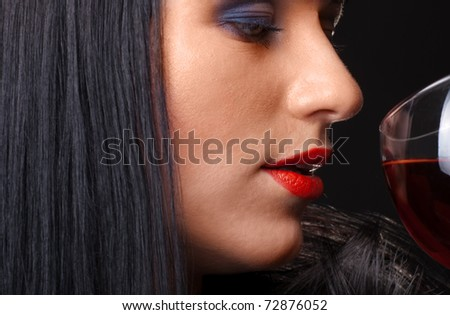 Red lips and glass of wine close up