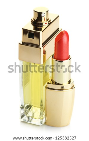 Red lipstick and perfume bottle isolated on white background.