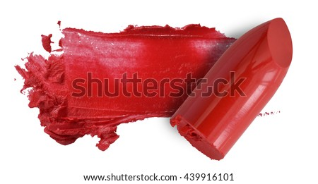 Red lipstick bullet smudged isolated on white