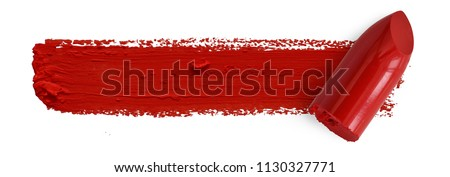 Red lipstick bullet smudged isolated on white with copy space