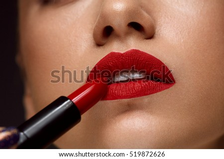 Red Lipstick. Closeup Of Woman Face With Bright Red Matte Lipstick On Full Lips. Beauty Cosmetics, Makeup Concept. High Resolution Image #519872626