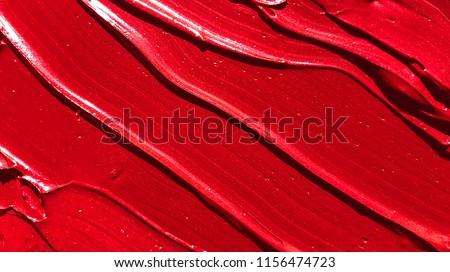 Red lipstick texture background.