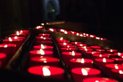 Red Lit Candles in Church
