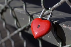 Red lock for love on Paris bridge, Leopold Sedar Senghor.