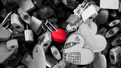 Red Lock in heart shape, Concept conveys deep true love or one love, which is as tenacious as the padlock. (For Valentine's Day content or abstract background), (Padlock without brand)