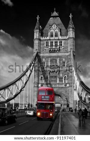 Red London Bus driving across Tower Bridge