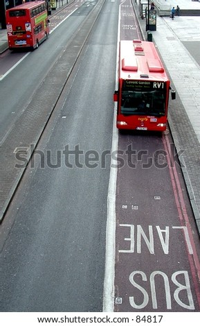 Red london buses, using bus lanes.