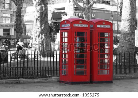 Red London telephone boxes at Leicester Square (on a B&W background)