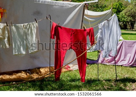 Red Long Johns and laundry hanging on an outdoor clothes line to dry during an American Civil war reenactment ストックフォト ©