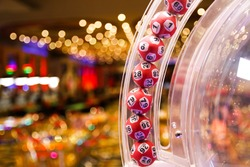 Red lottery balls in a bingo machine.Gambling machine and euqipment.