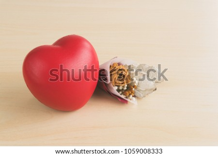 Red love heart and dried flower bouquet on wood table #1059008333