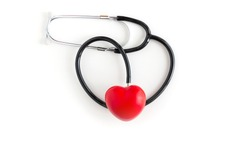 Red love heart and stethoscope on white background. Red heart and a stethoscope. Medical stethoscope and heart isolated on white. Heart, Health care concept.