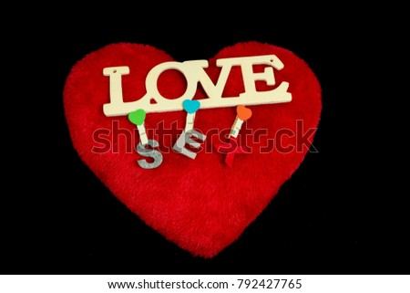 Red love heart and Valentine's Day symbols on black background. #792427765