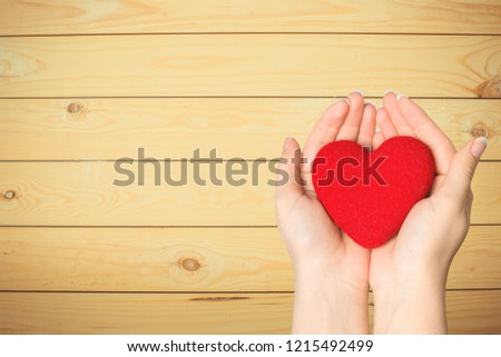 Red love heart in puzzle jigsaw pattern #1215492499