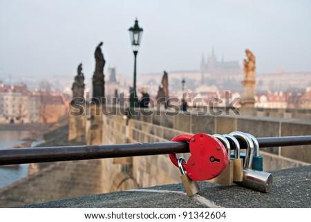 Red love heart padlock on the Charles Bridge in Prague