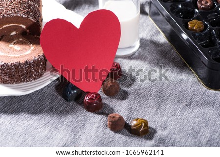 Red love heart shape card and chocolate. #1065962141