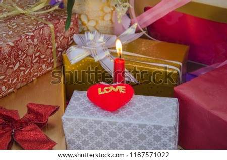 Red love heart with candle and present boxes #1187571022