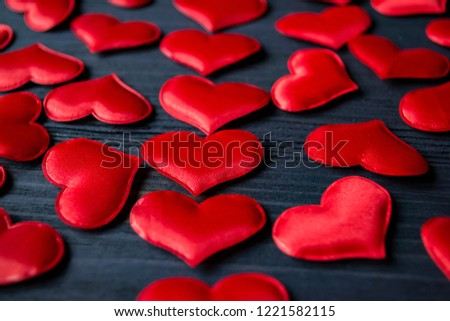 Red love hearts on a blue wooden background. Valentine's Day background. #1221582115